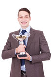 Winning businessman holding his award Stock Photography