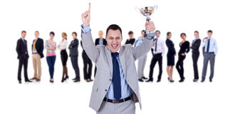 Winning businessteam leader holding trophy Stock Photo