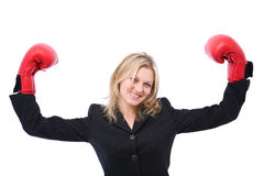 Winning businesswoman. Portrait with boxing gloves on white Royalty Free Stock Photo