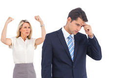Winning businesswoman her anxious coworker Royalty Free Stock Photo