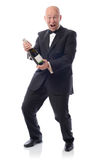 Winning champagne. Man in tuxedo with a bottle of champagne winning Stock Photos