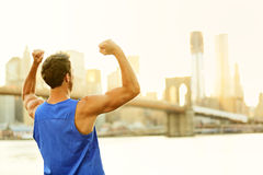 Winning cheering success fitness man in New York stock photography