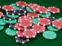 Winning chips. Pile of betting chips winner payout on green felt Stock Image