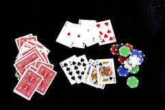 Winning combination. Poker combinations, chips and playing cards on a table Stock Photo