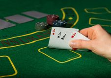 Winning combination in poker game. Cards and chips on a green cloth royalty free stock images