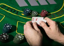 Winning combination in poker game. Cards and chips on a green cloth stock image