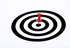 Winning concept. Dart's hit the bull's eye isolated on white background royalty free stock photos