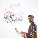 Winning concept. Side view of handsome young businessman using laptop on white background with city view and leadership sketch. Winning concept. Double exposure Royalty Free Stock Image
