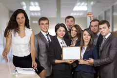 Winning corporate business team and beutiful. Winning corporate business team Six people dressed according to business dress code keep awarding blank certificate stock photo