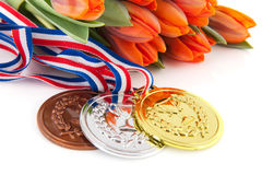 Winning the Dutch team. Winning the Dutch sporters with medals and orange tulips Royalty Free Stock Photos