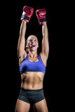 Winning fighter with arms raised Royalty Free Stock Photos
