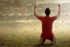 Winning football player Stock Image