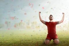 Winning football player royalty free stock photos