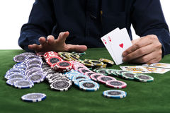 The winning gambler hand grabbing a pile of chips royalty free stock images