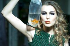 Winning girl with goldfish Stock Image