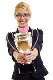 Winning a gold cup. Picture of an attractive businesswoman winning a gold cup Royalty Free Stock Images