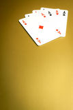Winning gold poker. Detail of poker hand on gold background royalty free stock image