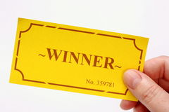 Winning Golden Ticket. Hand holding the winning golden ticket out for first prize or a reward Royalty Free Stock Images