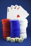 Winning hand. Four aces behind chips and dice Royalty Free Stock Photos