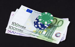 Winning hand. Money and casino chips Royalty Free Stock Photography