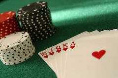 Winning Hand. Winning poker hand and stack of chips close up selective focus Stock Photography