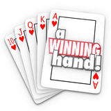 A Winning Hand Royal Flush Playing Cards Words. A Winning Hand words on a royal flush in playing cards as a competitive advantage in a game like poker, life stock illustration