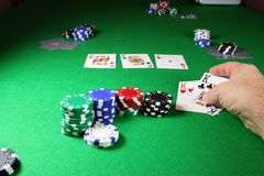 The winning hand - Showing quad kings. On green baize Stock Images