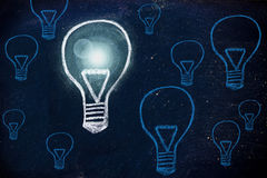 Winning idea, chalk design with lightbulbs. Metaphor of one unique winning idea Royalty Free Stock Photos