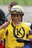 Winning Jockey Edgar Prado. SARATOGA SPRINGS - JUL 23: Jockey Edgar Prado gets a congratulatory fist pump after piloting Silvislip to her first win in a Royalty Free Stock Photography