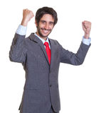 Winning latin businessman with beard Stock Photo