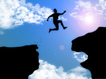 Winning Leap. A man jumping between 2 cliffs on high altitude, showing courage and sports spirit Stock Photography