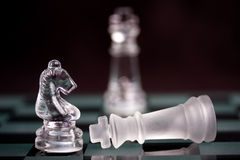 Winning and losing. Chess pieces showing winner and loser stock image