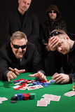 Winning and losing card players. Photo of two male poker players, one winning and the other losing, while security watches over their shoulders. Cards have been Royalty Free Stock Photos