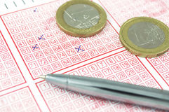 Winning lottery ticket. And euro coins Royalty Free Stock Photography