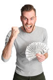 Winning man with cash Stock Images