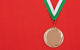 Winning medal. Blank winning medal, in red background Royalty Free Stock Photos