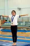 Winning medal. Young girl wearing proudly her gymnastics competition medal after winning a competition royalty free stock photo