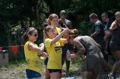 Winning a medal. A runner is given a medal for finishing the 2012 Northwest Indiana mudathlon Stock Photography