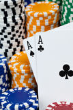 The Winning Pair. A pair of black aces set on top a large pile of poker chips Royalty Free Stock Photography