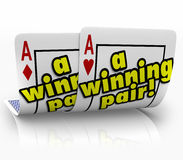 A Winning Pair Playing Cards Two Aces Successful Team Partners. A Winning Pair words on two aces on playing cards to symbolize a successful partnership or Royalty Free Stock Photography