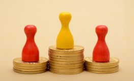 Winning Pawns concept on Golden Stack of Coins Royalty Free Stock Image