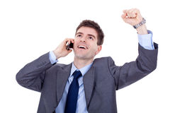 Winning on the phone. Happy business man with cellular phone winning over white Royalty Free Stock Photography