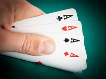 Winning playing cards in a man hand Royalty Free Stock Image