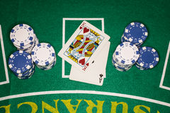 Winning Poker Card Hand Next To Blue and White Chi Stock Photos