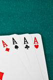 Winning poker hand. In corner in of a green fabric background royalty free stock photos