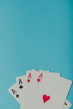 A winning poker hand of four aces playing cards Royalty Free Stock Image