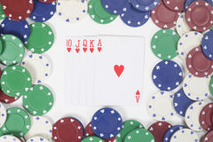 Winning poker hand with frame of casino chips. Showing a straight royal flush viewed from overhead in a concept of gambling Stock Photos