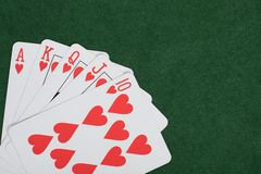 Winning poker hand with a royal straight flush. In hearts arranged in the corner Stock Images