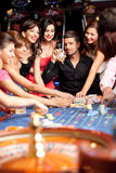 Winning roulette friends Royalty Free Stock Photography