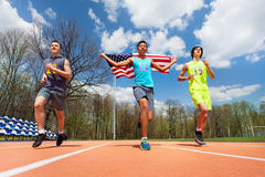 Winning runners with USA flag celebrating victory Royalty Free Stock Image